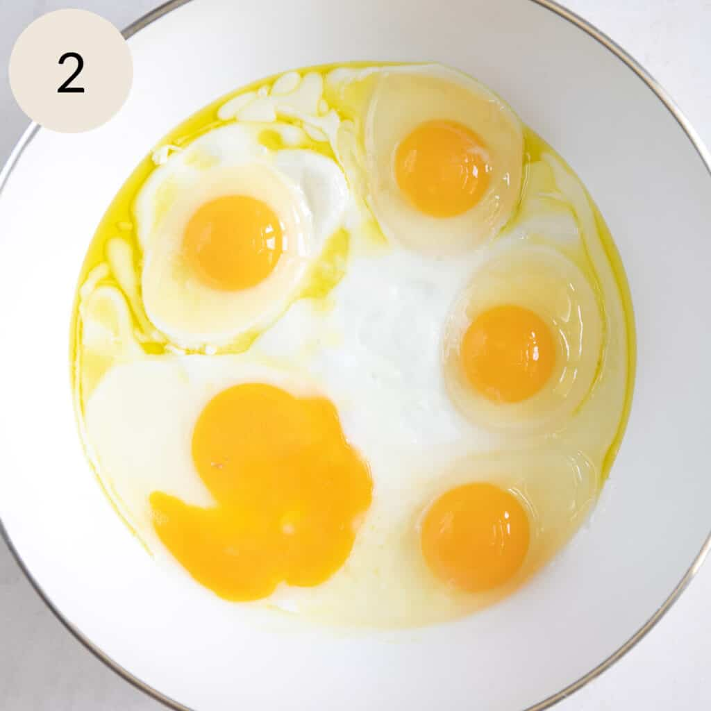 crack the eggs onto the olive oil