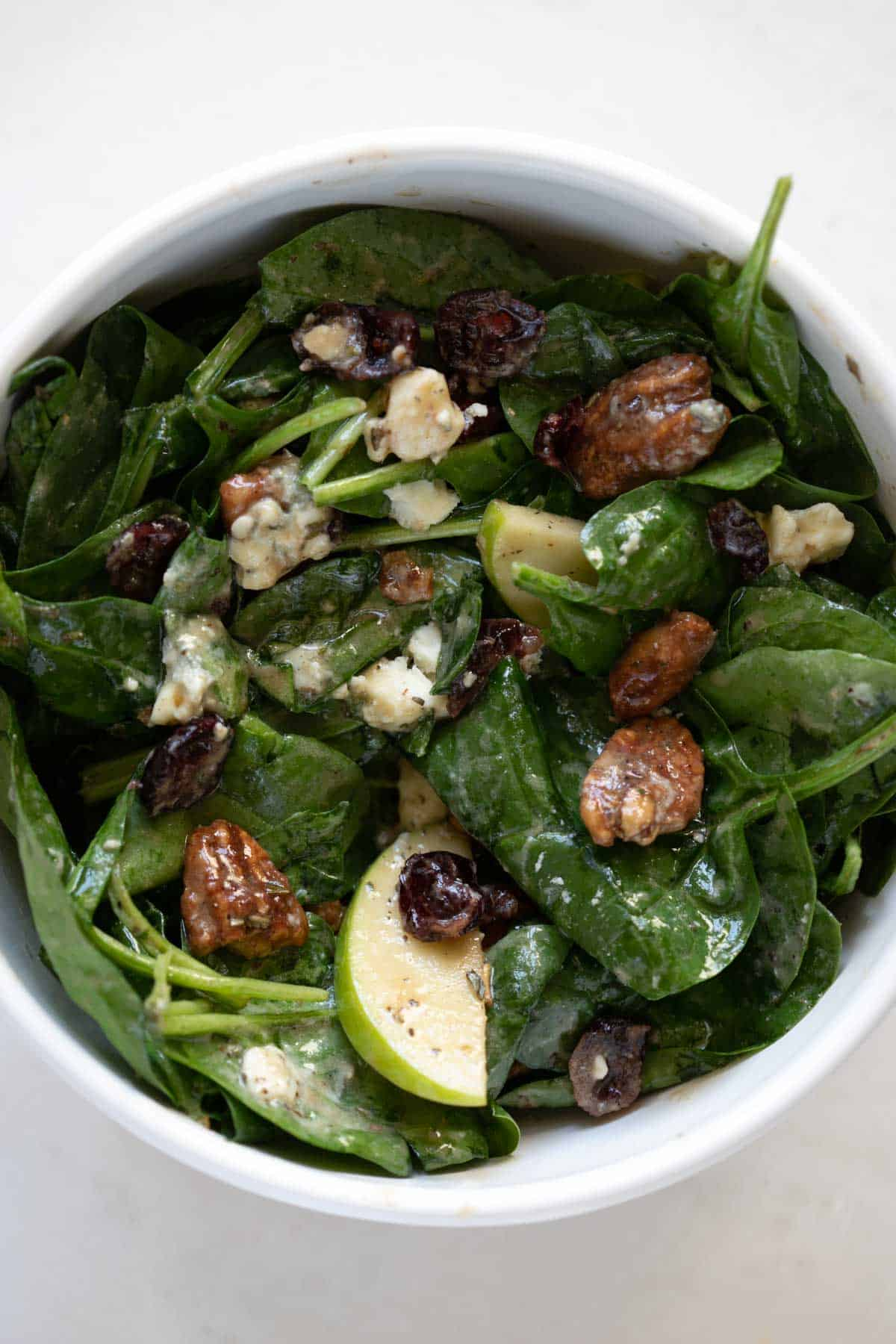 close up view of cranberry gorgonzola baby spinach salad