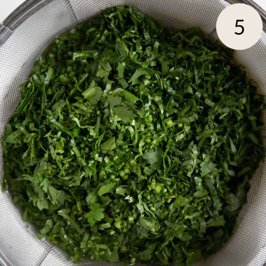 chopped Italian parsley in a strainer