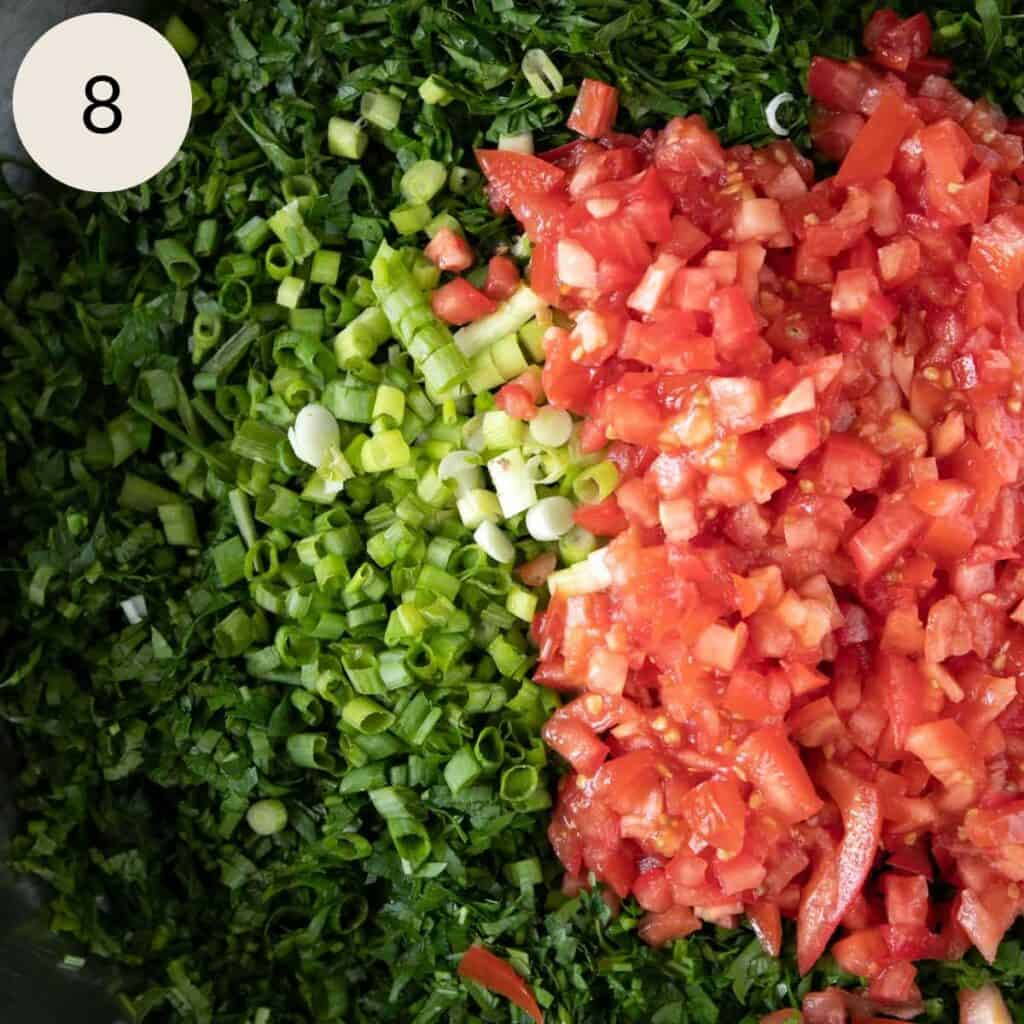 adding the Roma tomatoes to the chopped green onions and parsley