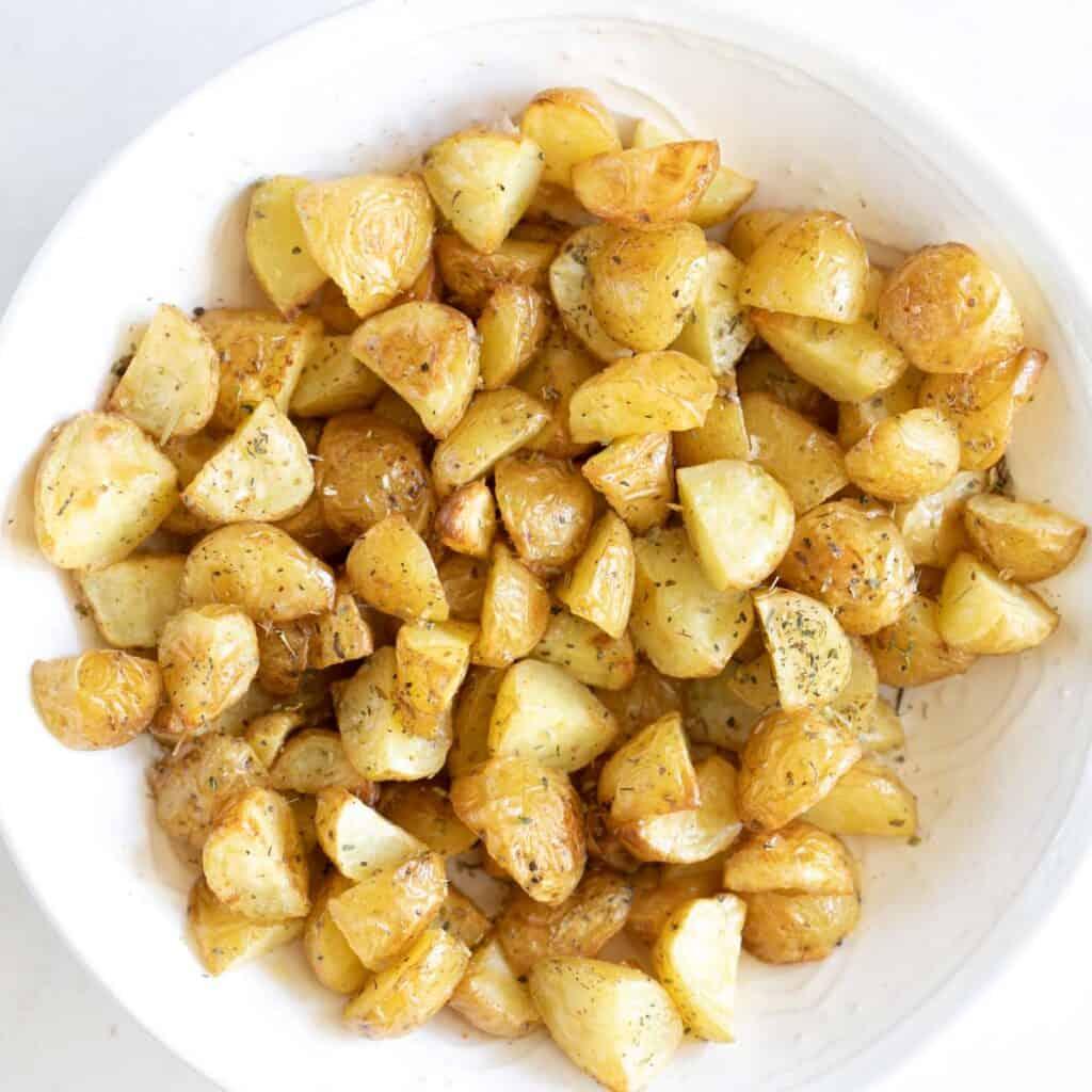 close up of Italian seasoning on roasted baby potatoes