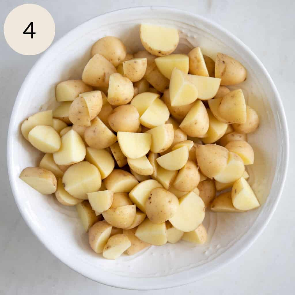 baby golden yellow potatoes in a white bowl