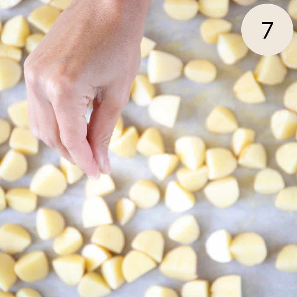 sprinkle some salt over the potatoes prior to putting them in the oven