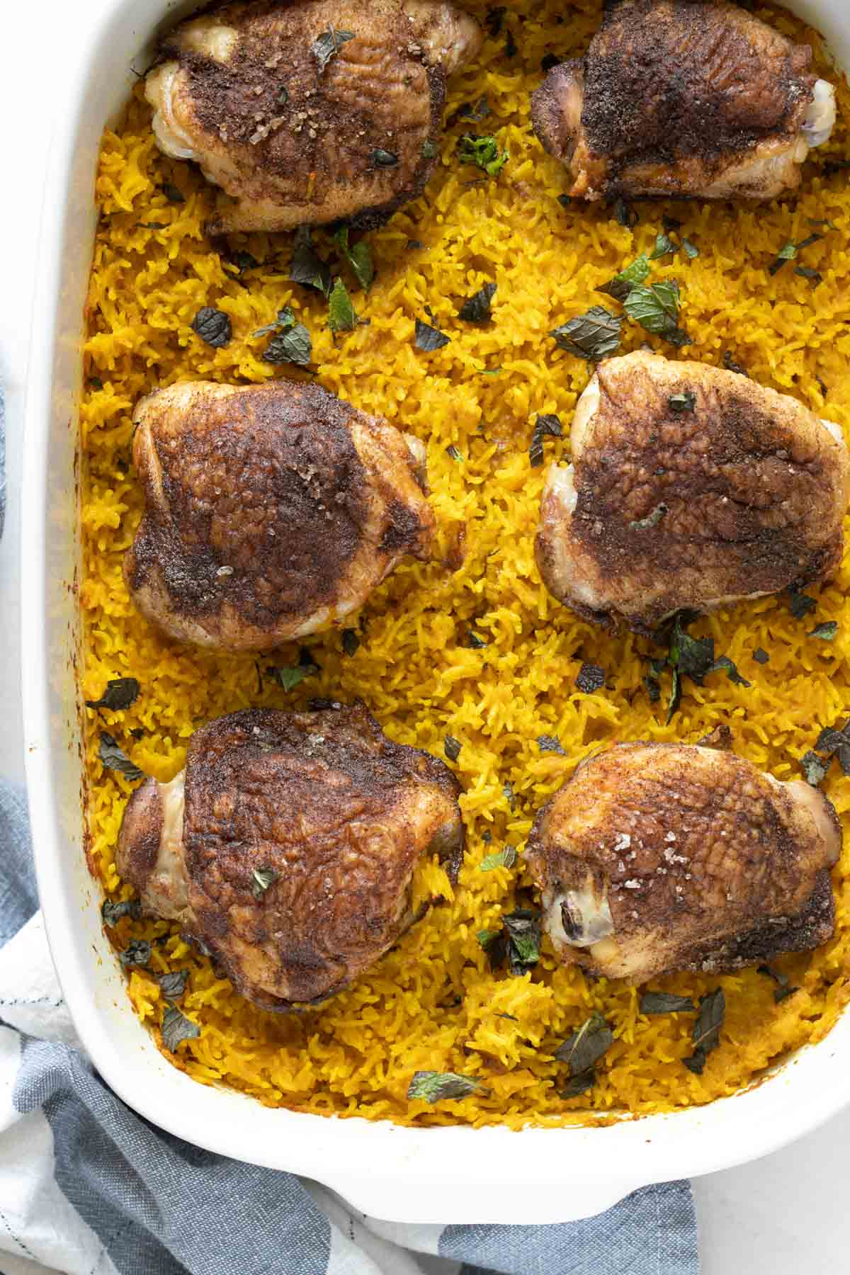 chicken thighs and basmati rice in a baking dish