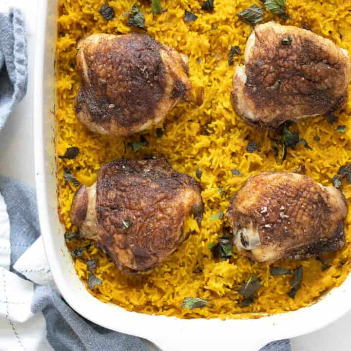 chicken thighs and turmeric basmati rice on the counter
