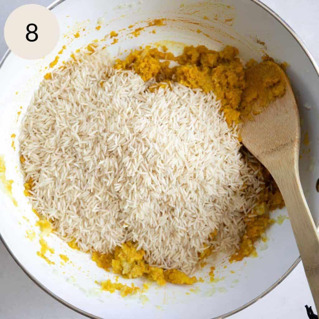 add the basmati rice to the turmeric onions