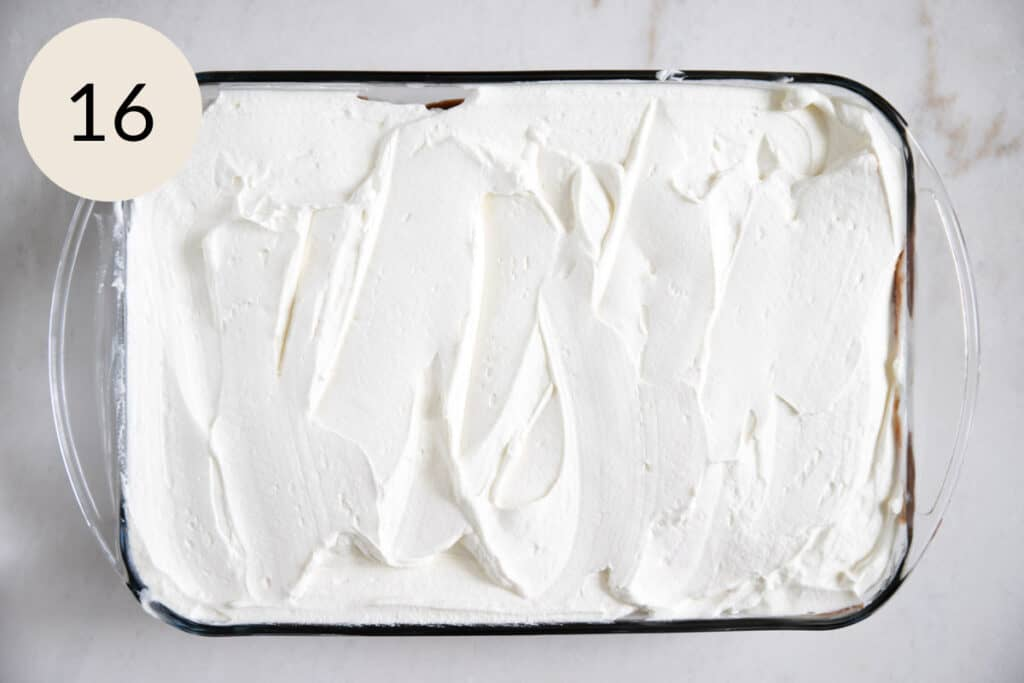 adding the whipped cream on top
