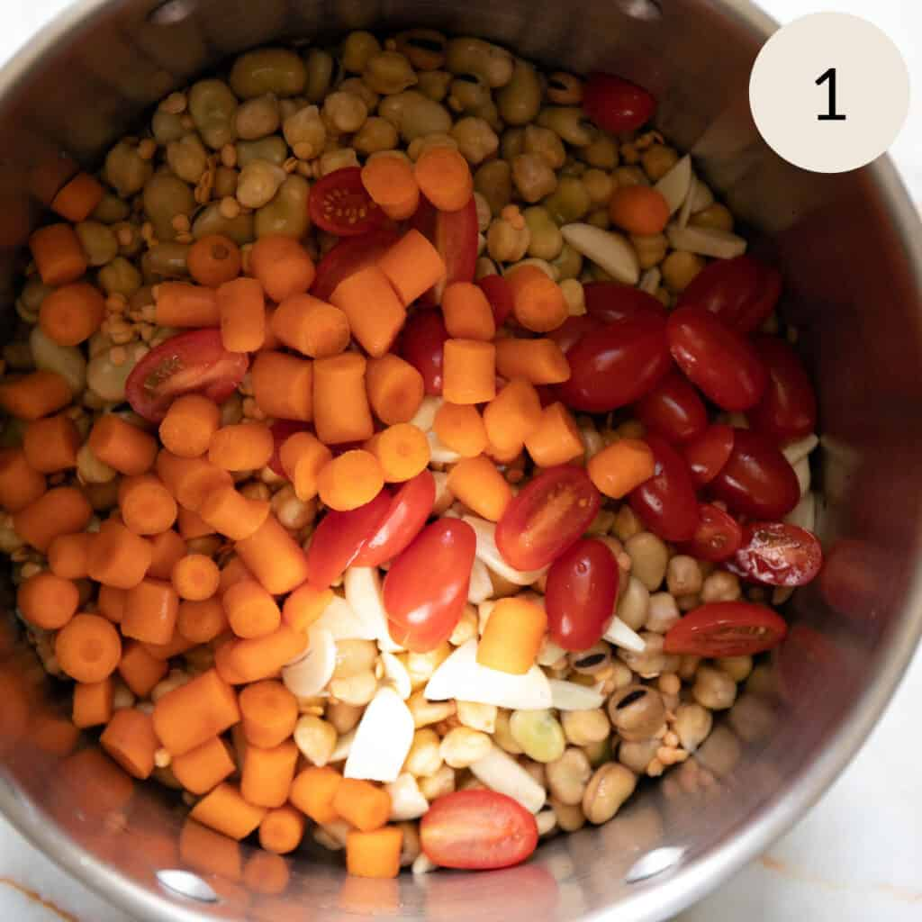 add the chopped carrots, tomatoes, and garlic to the pot