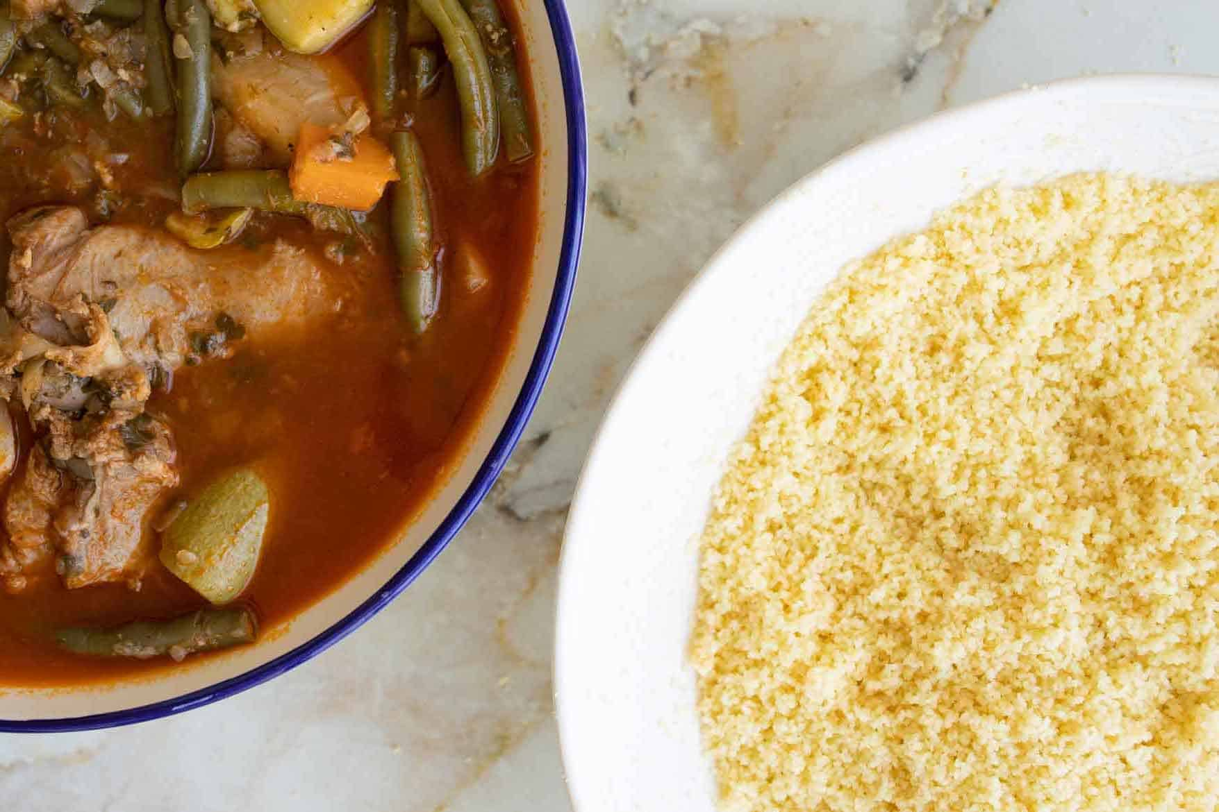 couscous in a bowl next to lamb shoulder stew