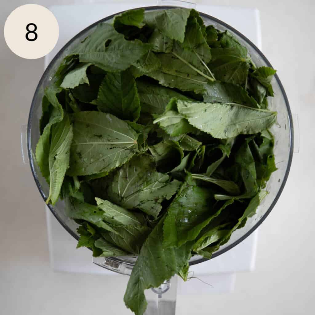 add the mulukhiyah leaves to the food processor
