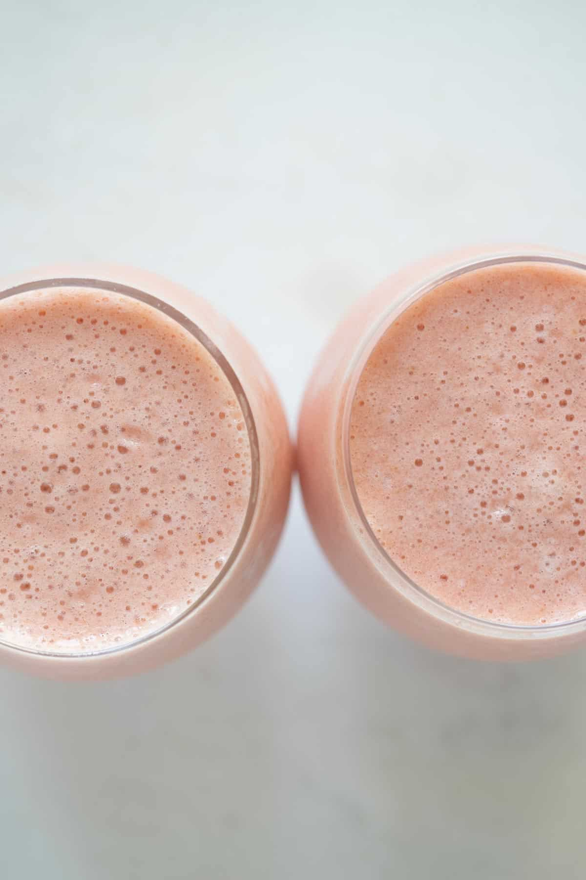 smoothie in 2 glass cups side by side