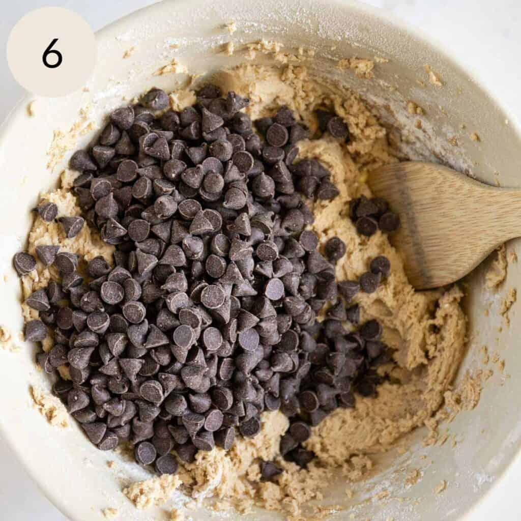 mix in the semi-sweet chocolate chips with a wooden spoon