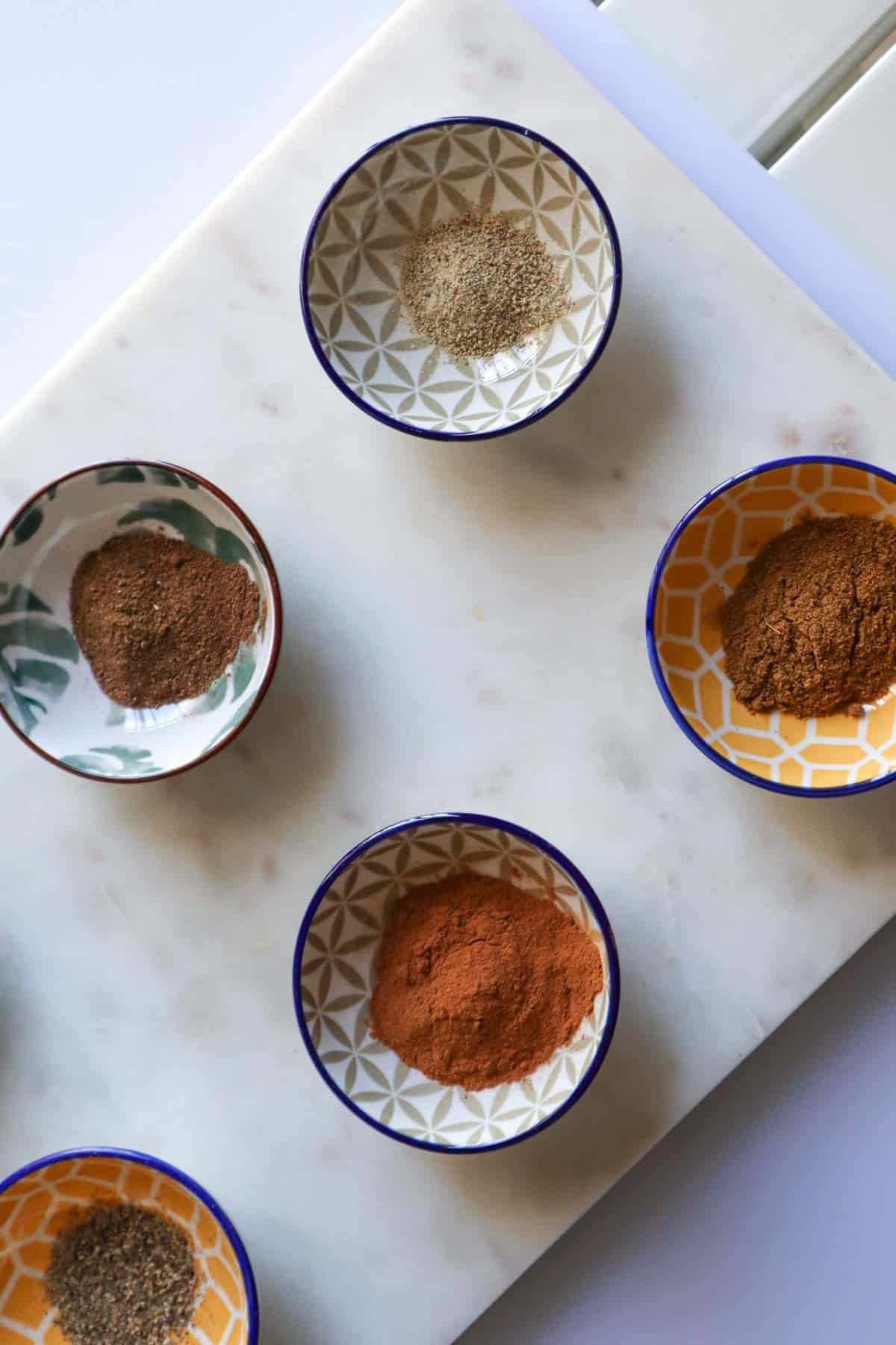 ground spices in little hand painted bowls
