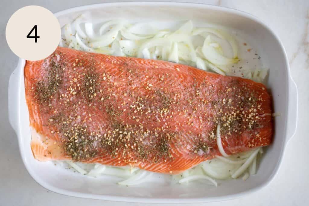 adding dried Italian herb seasoning and garlic granules on the steelhead trout recipe
