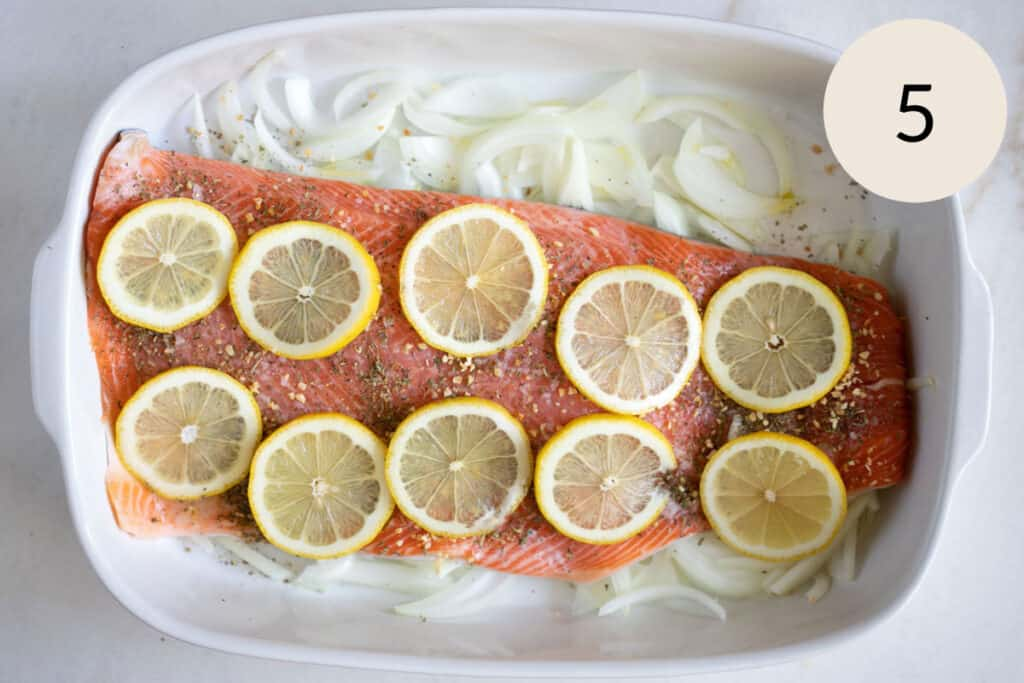 adding sliced lemons to the steelhead trout