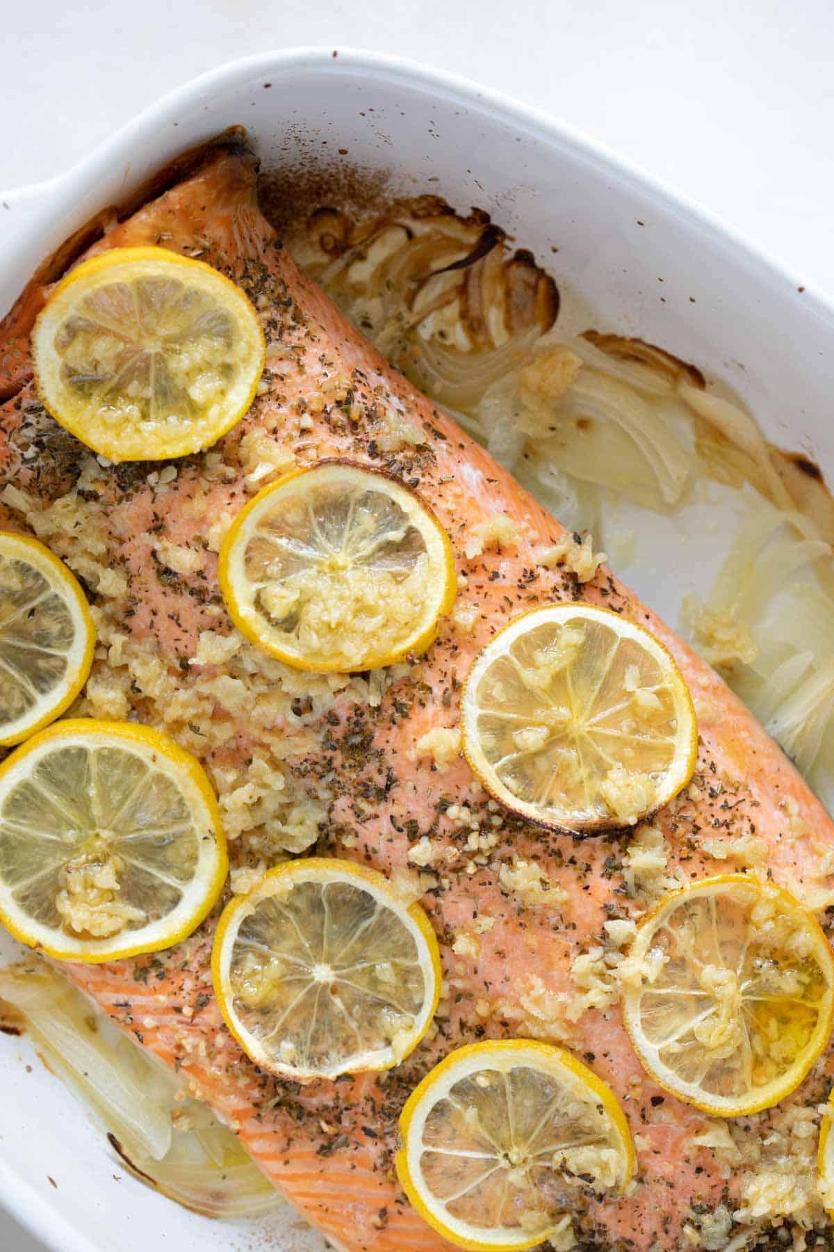 baked steelhead trout with sliced lemons