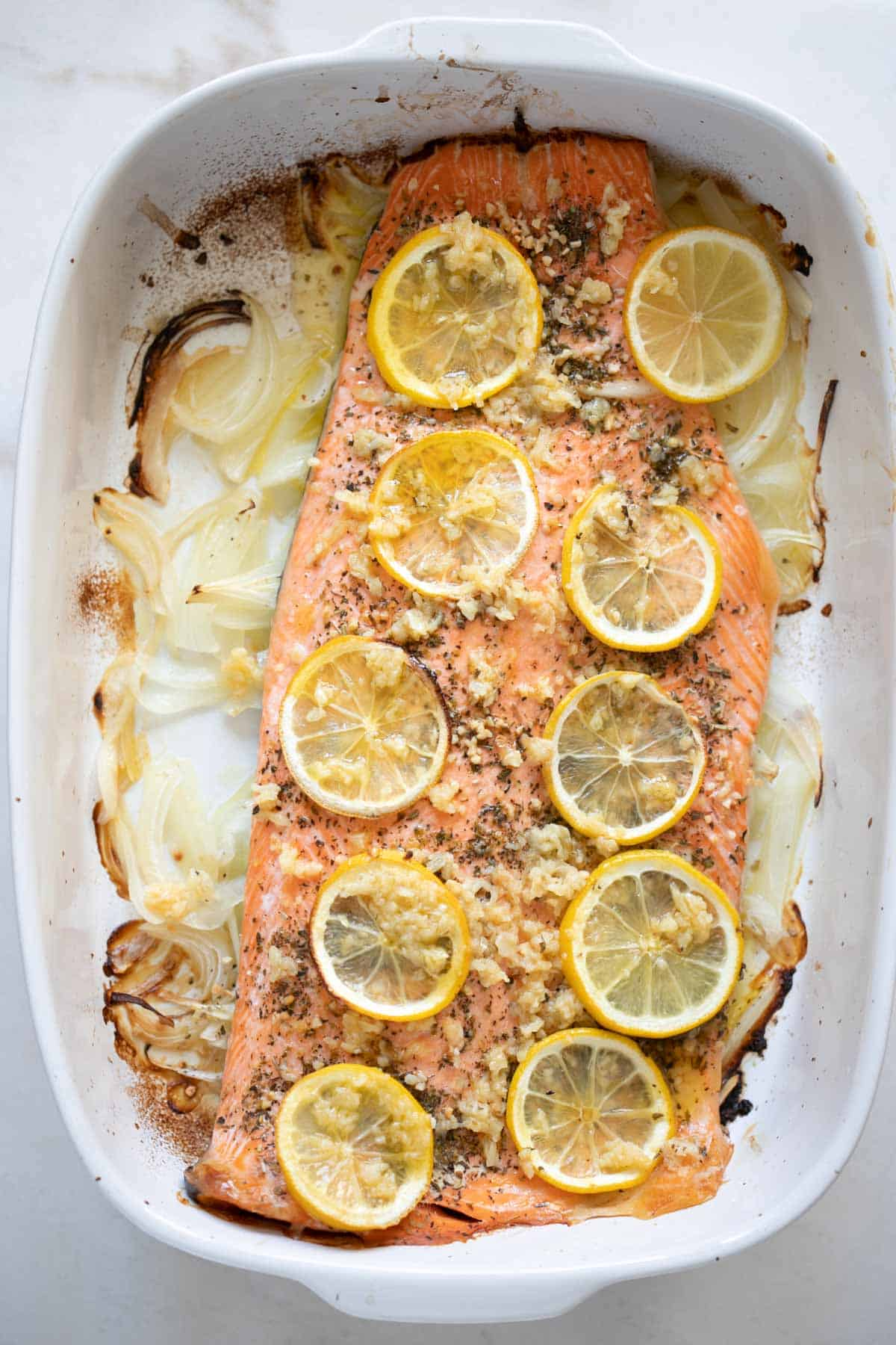 roasted lime butter garlic fish with sliced lemons