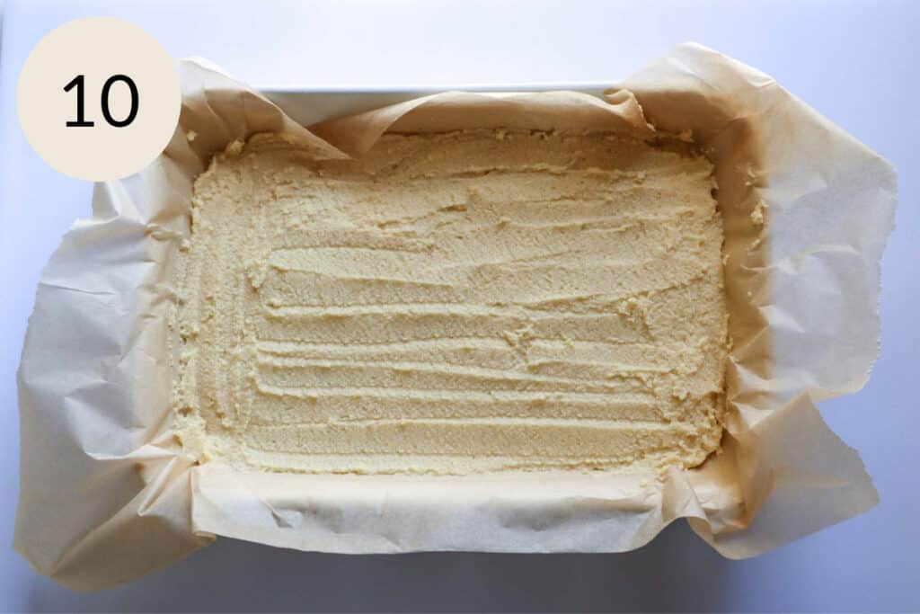 spread the semolina batter evenly in a parchment paper lined baking dish